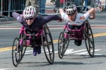 Amanda McGrory (103) and Susannah Scaroni (108) at mile 10 of the 2013 Boston Marathon